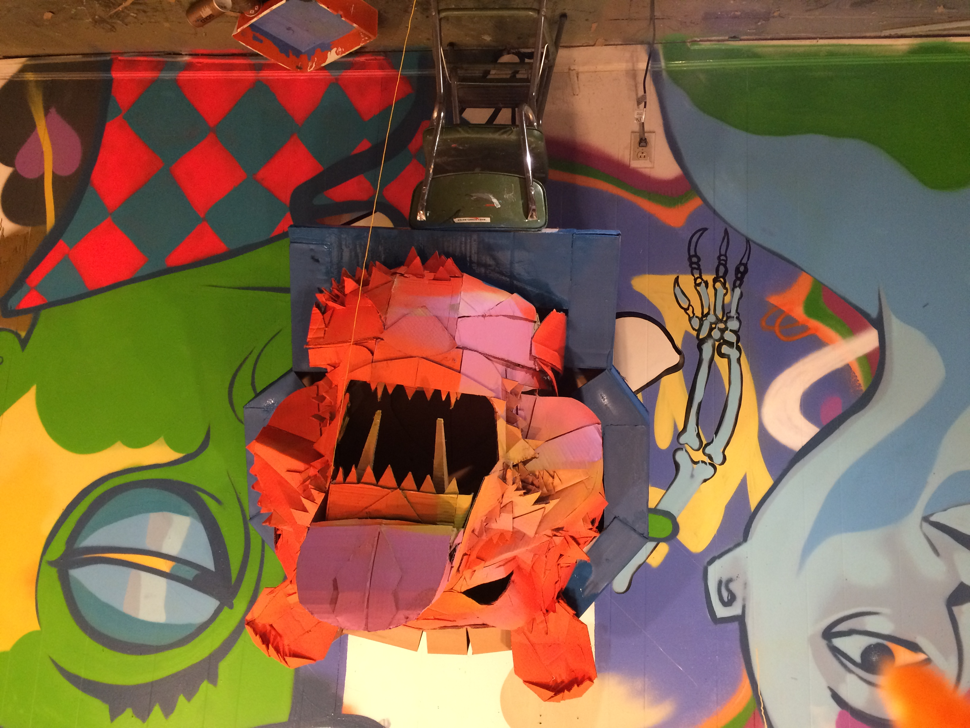 cardboard bear head on graffiti wall background